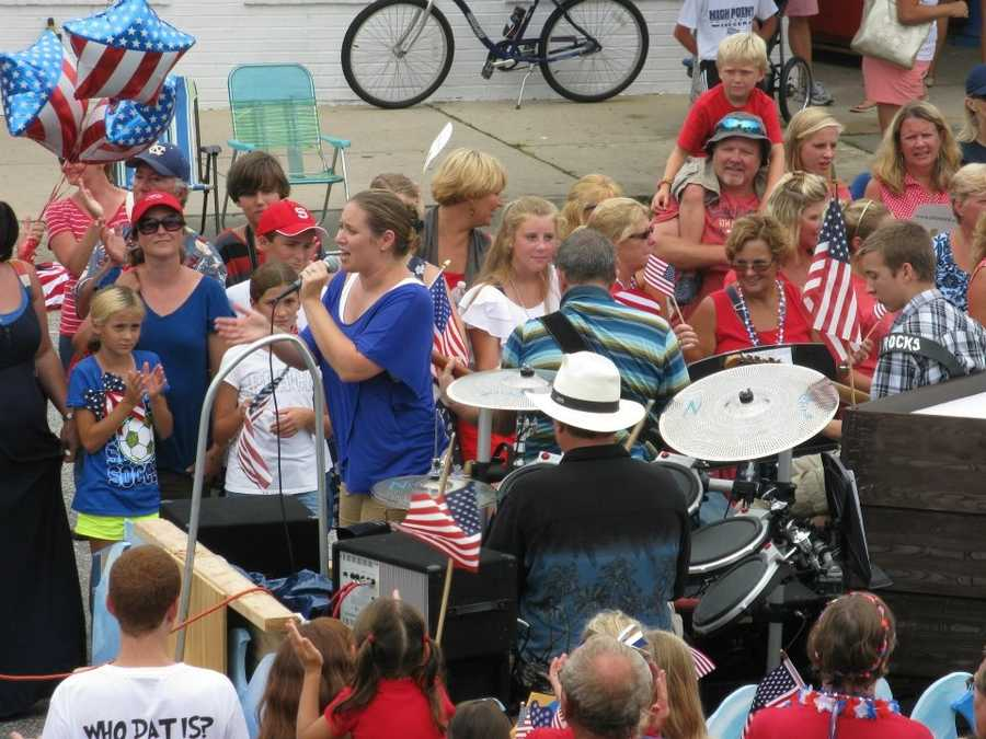 Members of a local church sing on one of the floats.