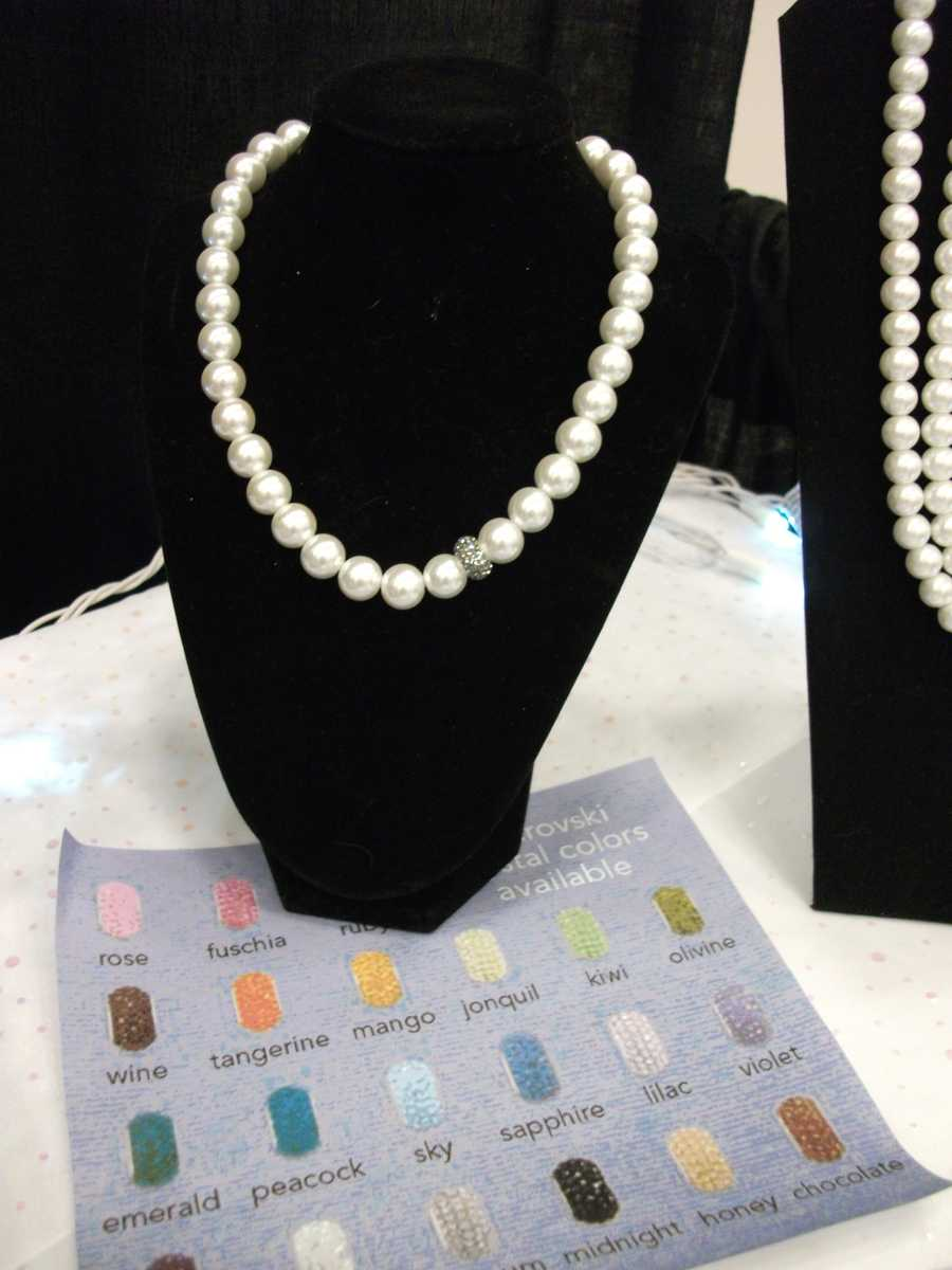 Pearl necklaces with one or more beads in the wedding colors for each bridesmaid and maid of honor would make nice gifts...(Ruby Surprise Gifts)
