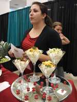 Representatives from Sagebrush Steakhouse where present at The Carolina Weddings Show to give out menus, talk with brides-to-be and grooms and serve some of the food they offer...