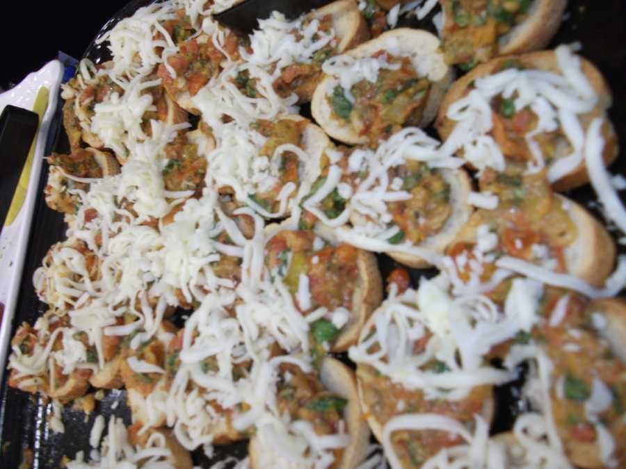 Several different plates were served to show the variety of foods by caterers for Whole Foods Market.Bruschetta was one of the favorites for wedding show guests...