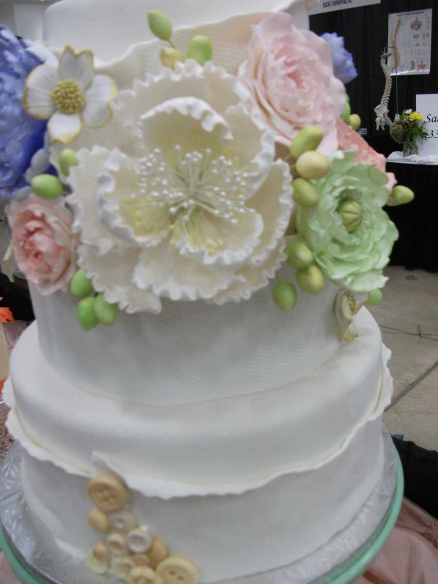 This cake has the top covered already with edible flowers...(Cakes & All Things Yummy)