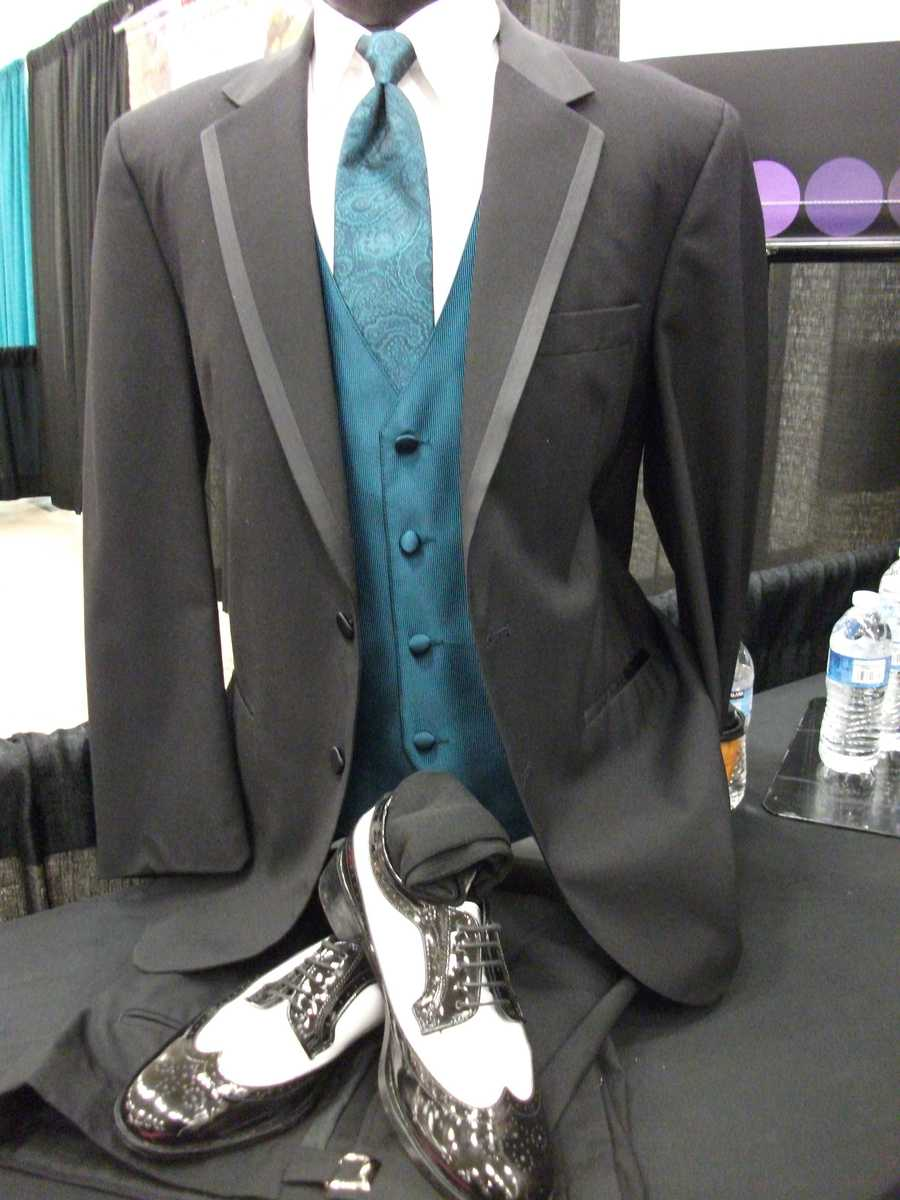 "Think wingtips and nice suits for a ""Great Gatsby"" or old Hollywood look with some color to your suit or matching colors for groomsman or the bestman...(The Men's Wearhouse Tuxedo Rentals)"