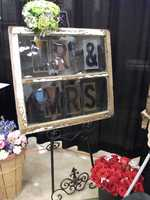 Dahlias Flowers decorated their booth with this neat window pane which could be a great idea to incorporate in your reception. Finding neat things at The Carolina Weddings Show is one reason to go!