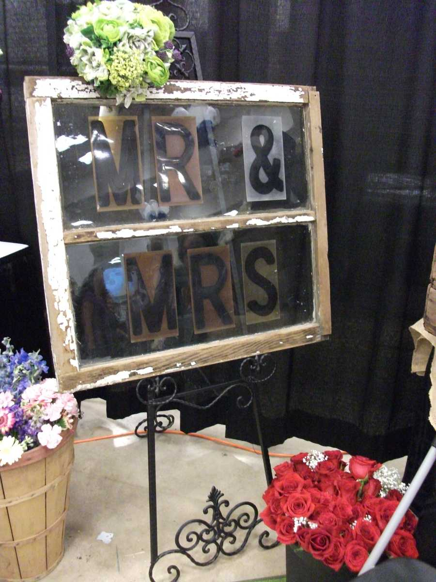 Dahlias Flowers decorated their booth with this neat window pane which could be a great idea to incorporate in your reception. Finding neat things atThe Carolina Weddings Show is one reason to go!