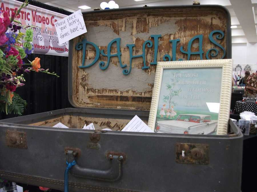 Dahlias Flowers had this suitcase for a drawing at The Carolina Weddings Show, but you could use this idea for guests to leave a note for the happy couple to always remember.