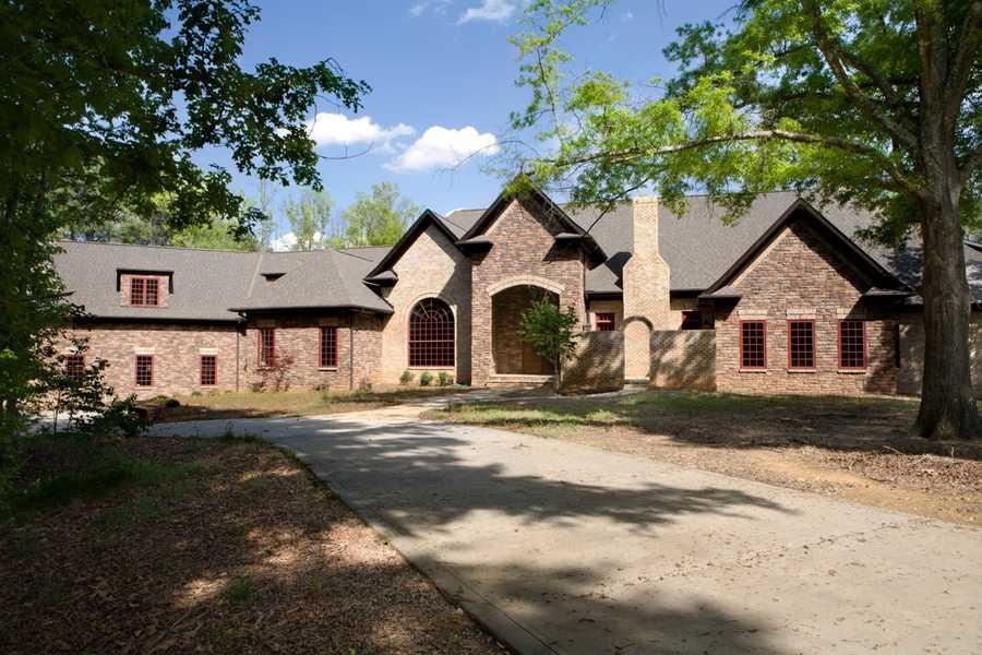 This two story Weddington home has over 9000 square feet and is priced at $2,250,000. The estate is situated on 6 acres with the rear elevation facing a 7 acre private pond.