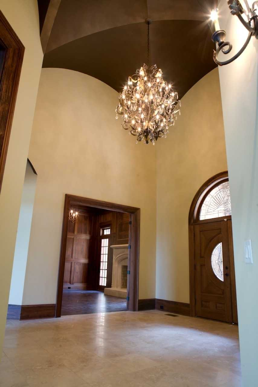 Two-story Foyer with a groin vaulted ceiling
