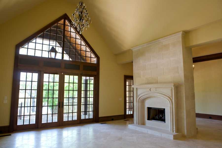 Family Room or Great Room with a limestone wall which features a double-sided fireplace
