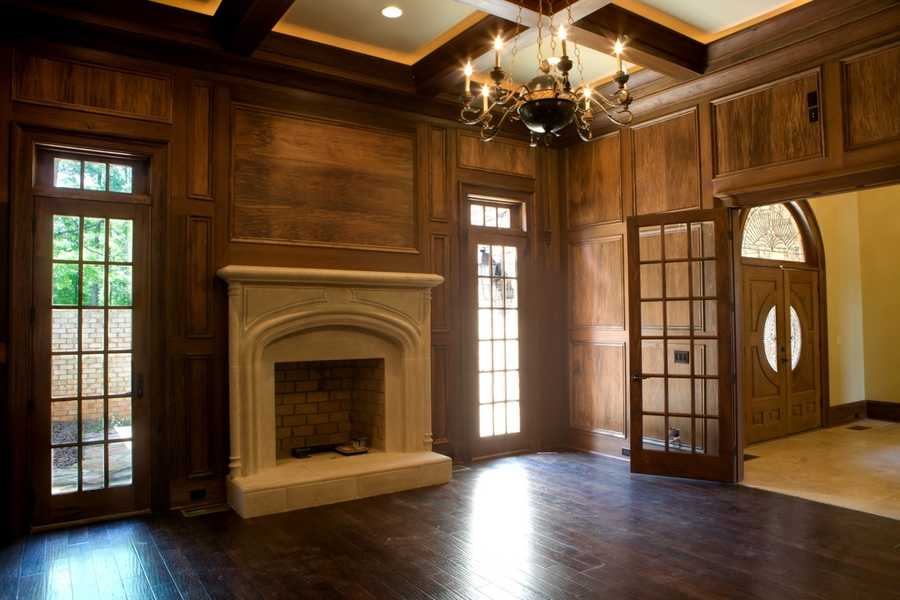 Home Office or Library with a cast stone fireplace and coffered ceiling