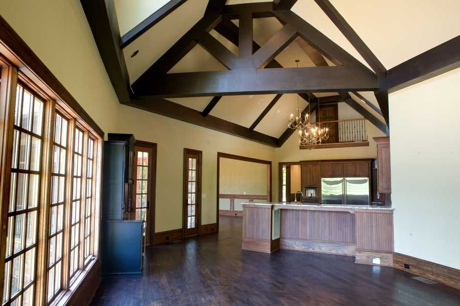 Keeping Room with lots of windows and beautiful wood beam ceiling