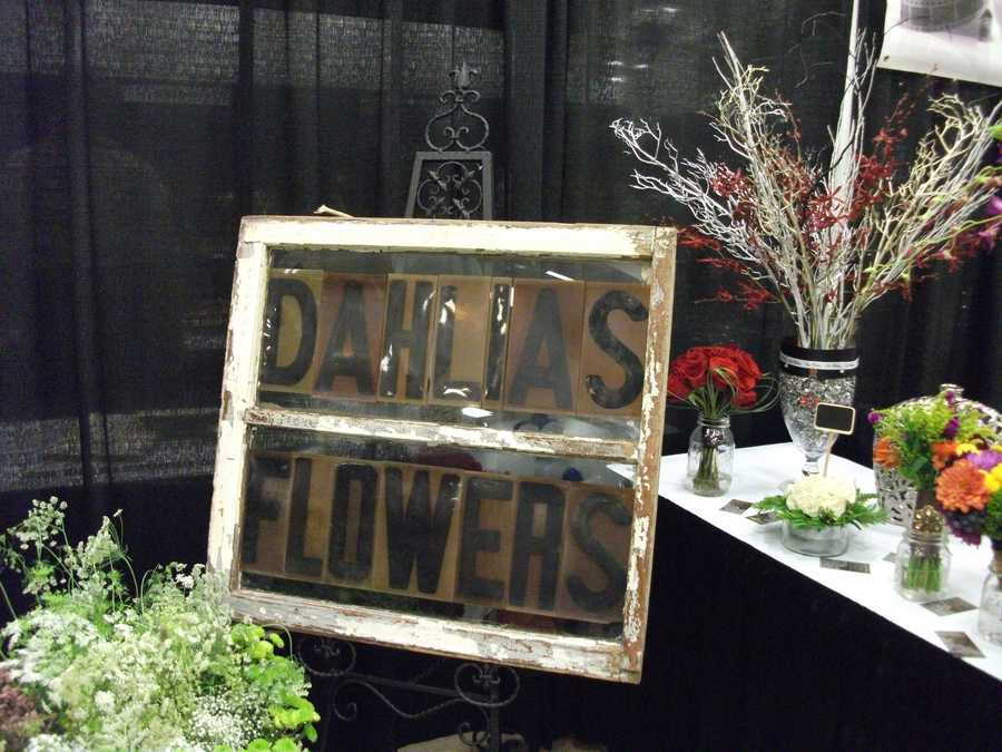 Nice sign for Dahlias Flowers at The Carolina Weddings Show which could be used for the wedding reception for the couples table.