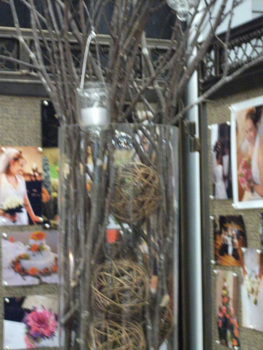 This vase decoration could be used for eco-friendly themed wedding or country/western themed wedding. (Beverly's of Midway Flower's and Gifts)