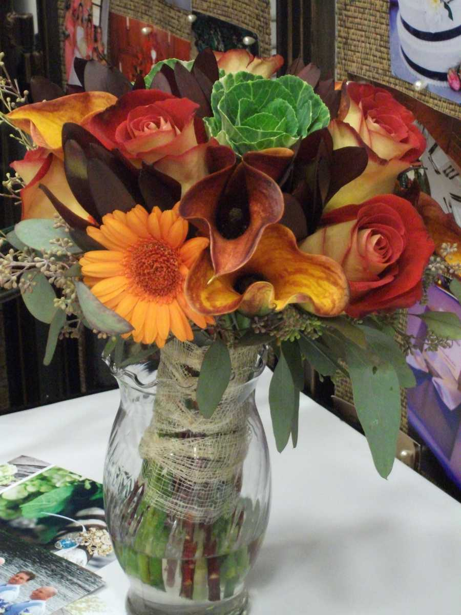 Fall Themed Wedding Bouquet or Reception table display.(Beverly's of Midway Flower's and Gifts)