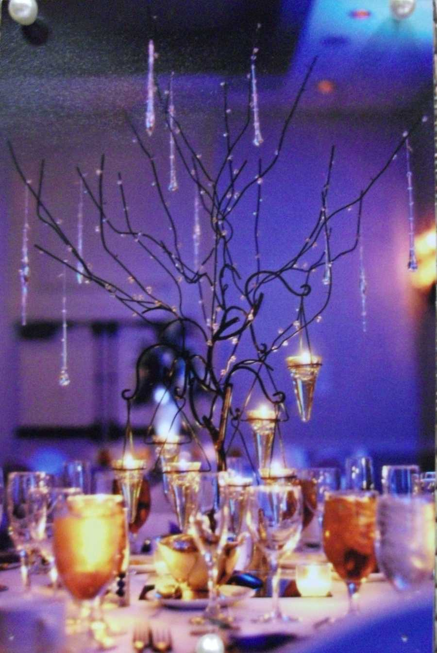 This centerpiece looks great as a holiday themed wedding vibe or any themed wedding with the purple lights on the walls. (Beverly's of Midway Flowers and Gifts)