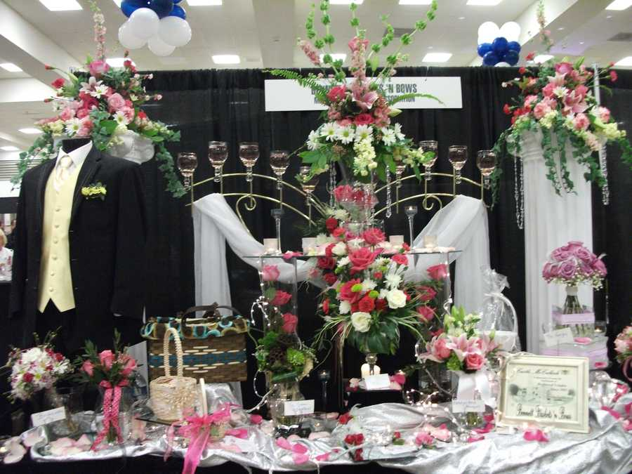 This booth was unique with all it's flowers and candles design by Bennett's Baskets N Bows.