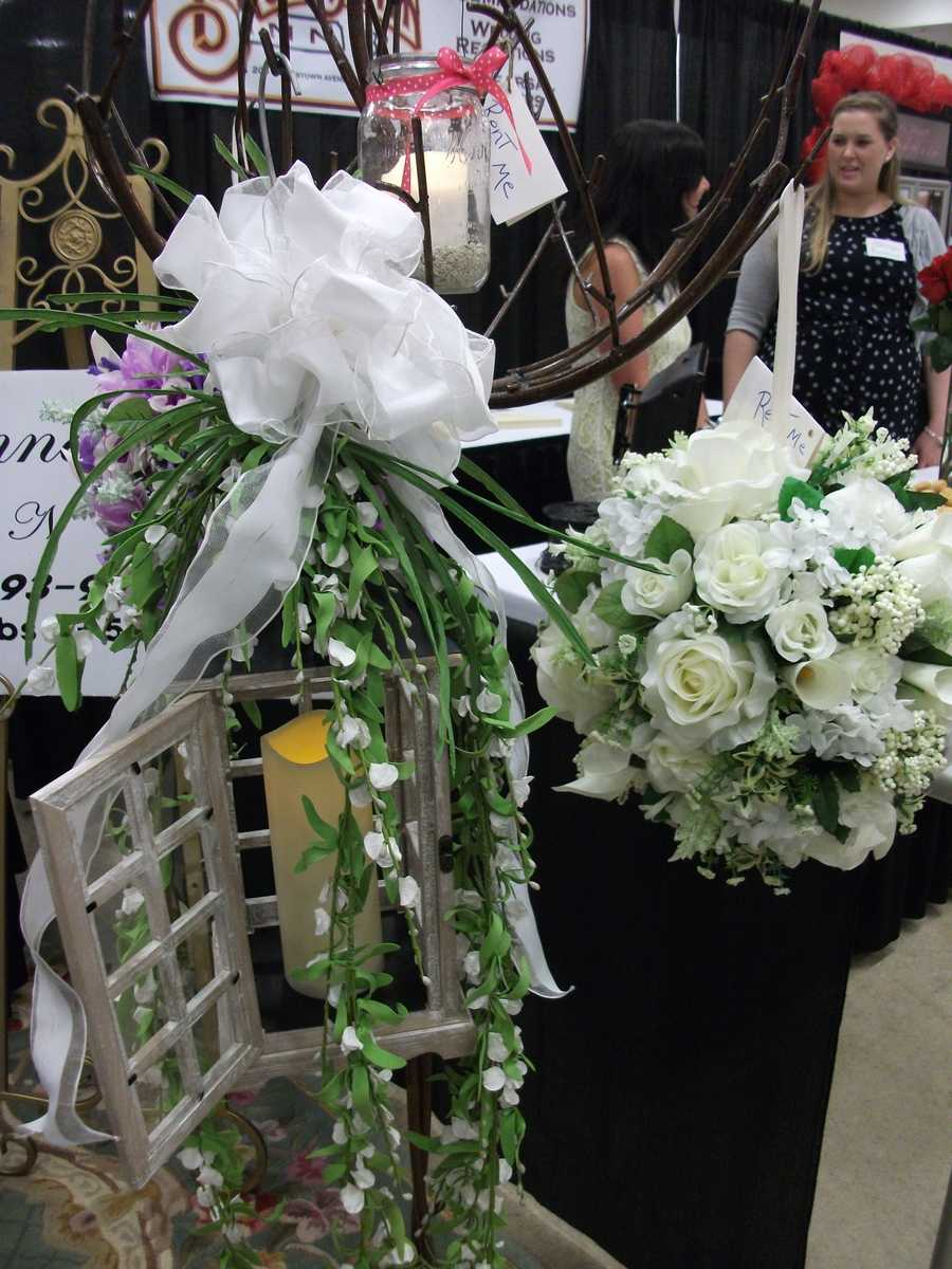 Bennett's Baskets N Bows made this unique candle holder with flowers for their booth at The Carolina Weddings Show. If you have the budget then this would be beautiful going down the aisle or maybe just two at the end of the aisle.