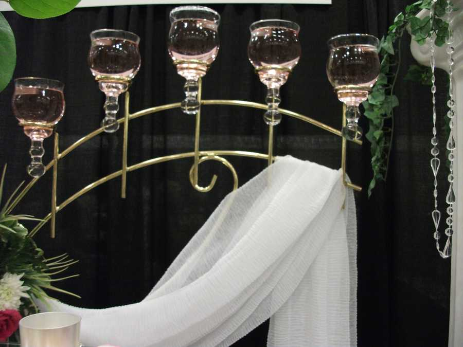Use candelabras with flowing cloth and jewels hanging off flower arrangements as decorations for your theme. (Bennett's Baskets N Bows)