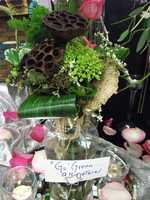 Eco-friendly centerpieces for your reception can be made with all kinds of flowers, leaves, berries and more. (Bennett's Baskets N Bows)