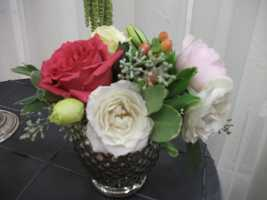 Even simple small centerpieces can be used with your wedding colors or style. (Weddings by Hummingbird Designs)