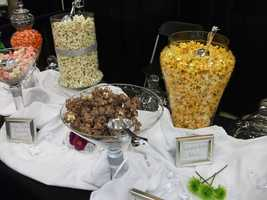 For your movie theme use fancy flavored popcorn and movie treats at a candy bar. (The Popcorn Fanatic)