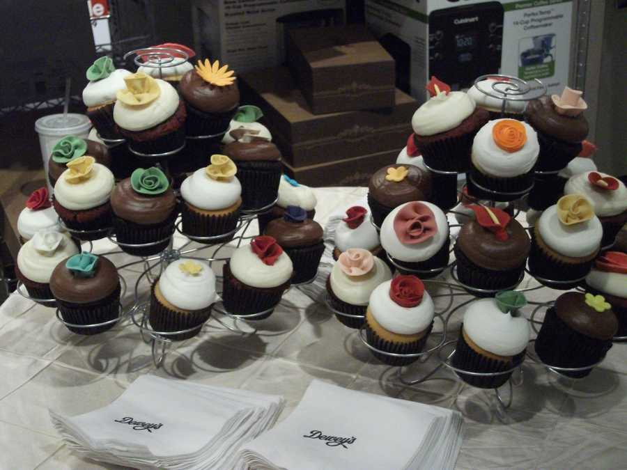 Cupcakes could be served as the wedding cake or in addition to the wedding cake at the reception. (Dewey's Bakery)
