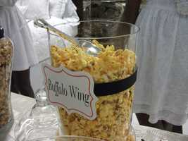 If you are having a Sports or Hollywood Themed Wedding then the popcorn and candies bar is a must at your wedding reception. (The Popcorn Fanatic)