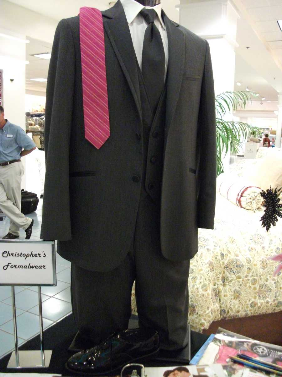 Suits with different color ties for the couples color theme were shown to everyone. (Christopher's Formalwear)