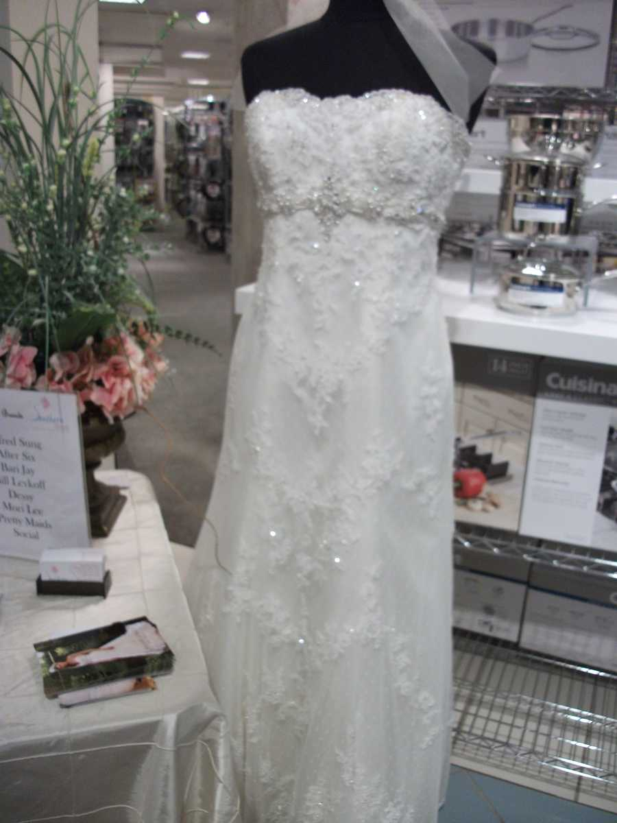 At the Belk Engagement Party, Southern Bridal has wedding gowns to show couples what they may want to wear.
