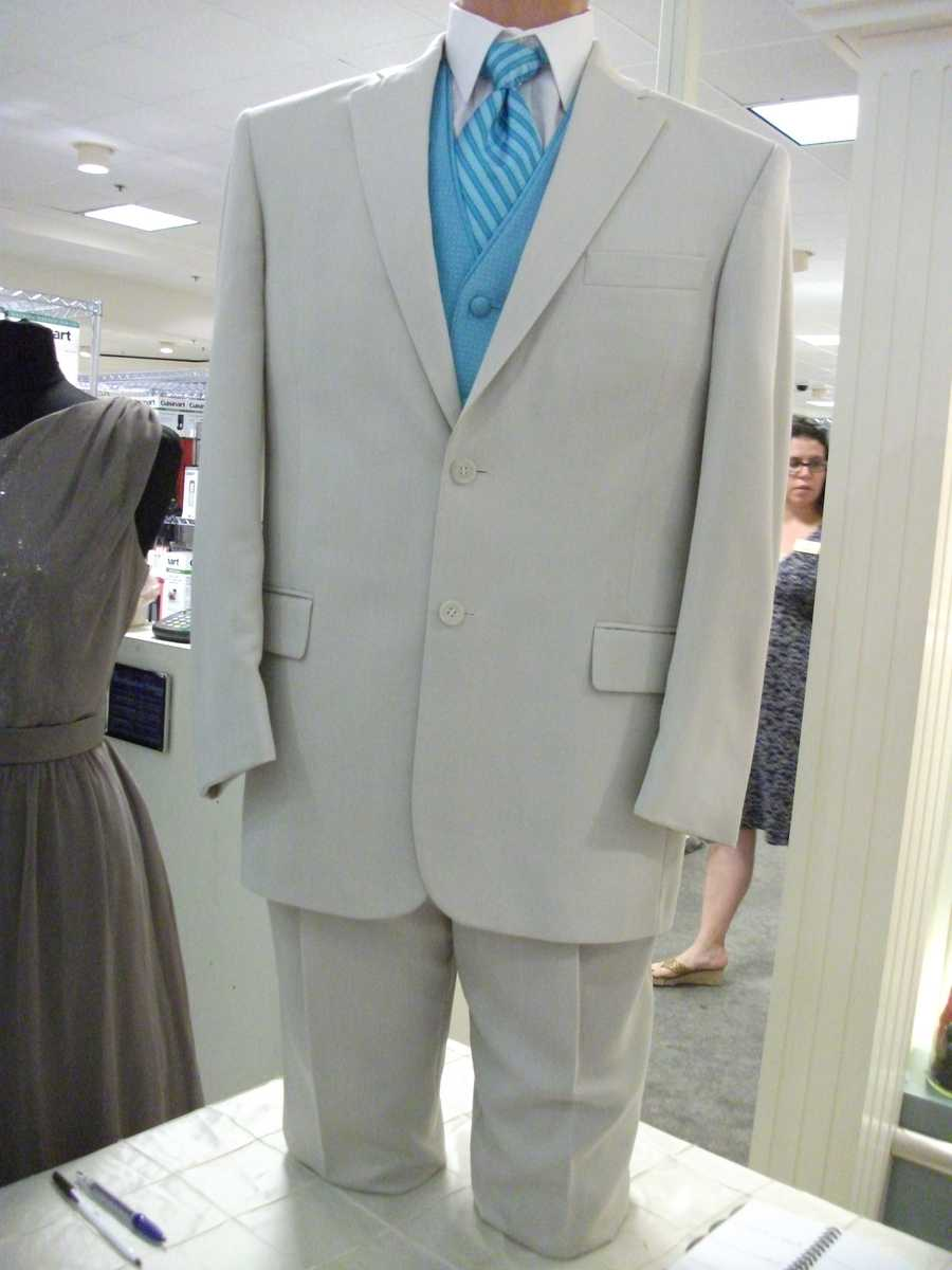 Nice suits with different modern colors for the groom and groomsmen to wear by Southern Bride.