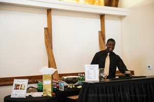 A catering company had a bar setup to serve WinMock Bridal Show guests drinks and also talk to them about service for the wedding parties and reception.