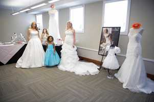 Models for different bridal stores walked around in wedding gowns and had flower girl dresses to show the guests at the WinMock Bridal Show.