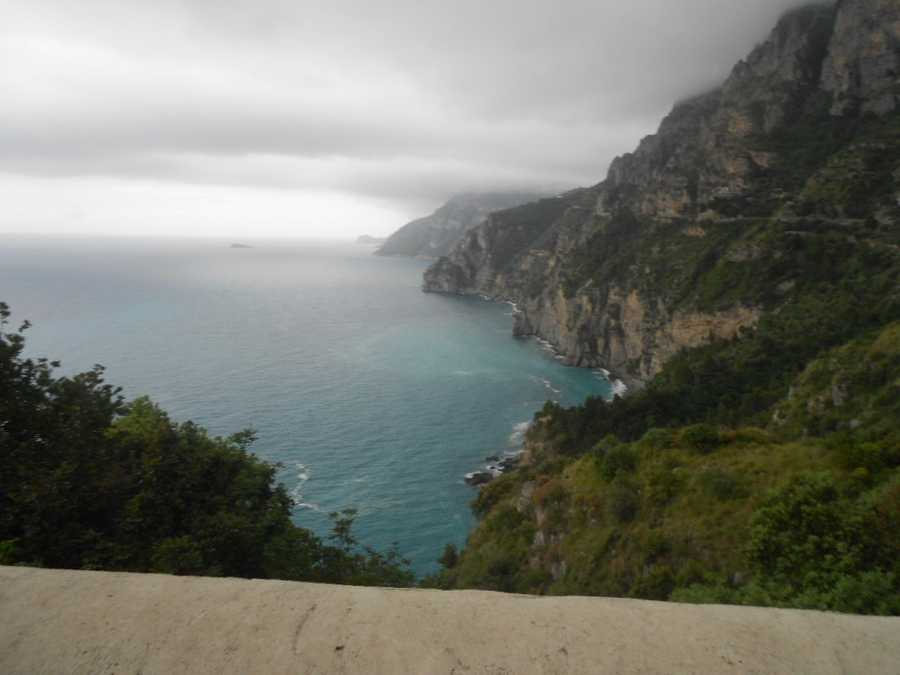 The mountains of the Amalfi coastline going from Sorrento into Positano, Italy. Wedding photos with these beautiful aqua waters and lush mountains would be memorable.