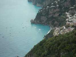 More Amalfi Coastline from Positano showing the small boats below. Some boat companies take small wedding parties to sea for small weddings if as a couple you would like that type of ceremony.