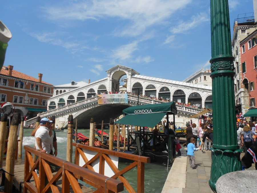 Time to get a gondola ride and go under the famous Rialto Bridge as a new couple for your wedding pics in Venice, Italy. It is said if you kiss as a couple while going under the Bridge of Sighs then you are to enjoy eternal bliss together.