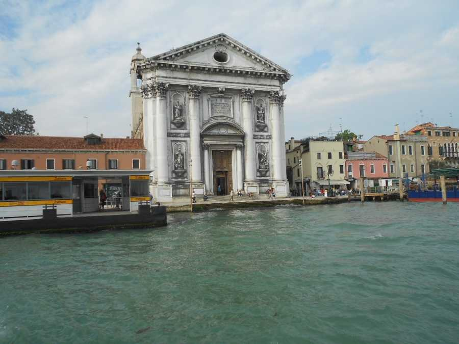 The Chiesa del Santissimo Redentore on thewaterfront of the Canale della Giudeccain Venice, Italy. Boats go between these canals and this would be a beautiful backdrop for wedding photos.