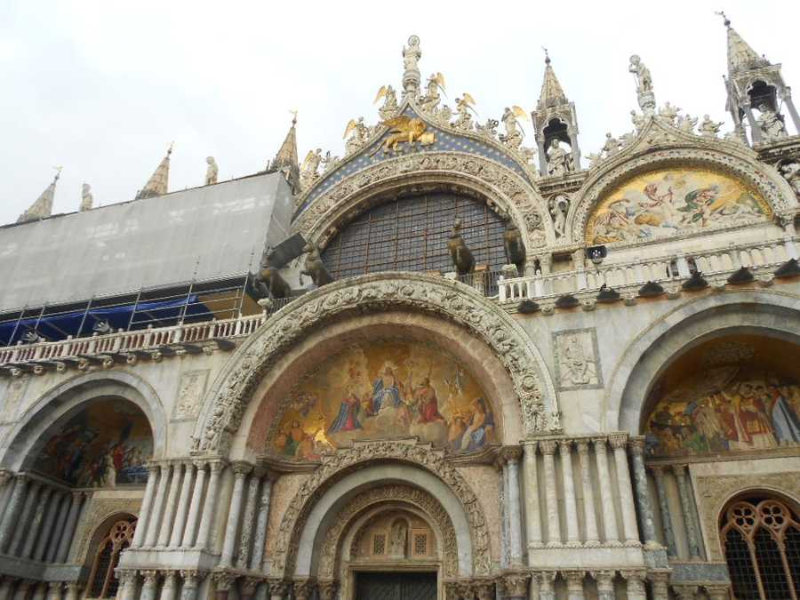 San Marco square also boasts its Basillica of San Marco (St. Mark of bible-study fame and his body, ashes and dirt is partly buried here because of theives trading for money). Beautiful historical places to visit and take photos for the whole wedding party to enjoy.