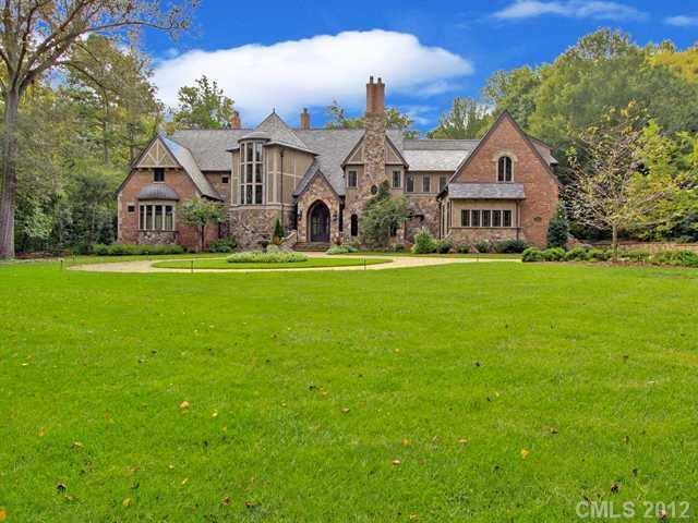 This 5 bedroom estate is located in Charlotte and priced at $5,500,000. The home includes a bar/wine room, a master suite kitchenette and a pool house with a sauna and exercise room.