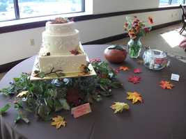 Decorating the tables with small leaves made of paper of cloth is a great idea too. Small flower arrangements with the leaves colors really match. These small accents could decorate all the tables or just a signing guest book, gift, name card or food tables.