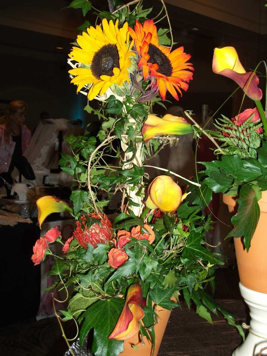 These colorful sunflowers make great giant flower arrangements for your reception tables.