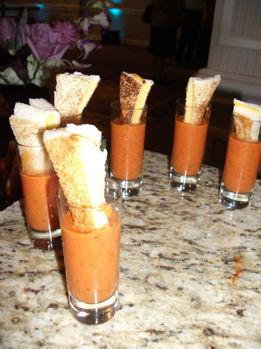 These great pumpkin or squash soups with a different kind of toasted cheese sandwich is great to serve at the wedding parties and/or reception. Watch howPepper Moon Cateringmakes these great foods and more information.