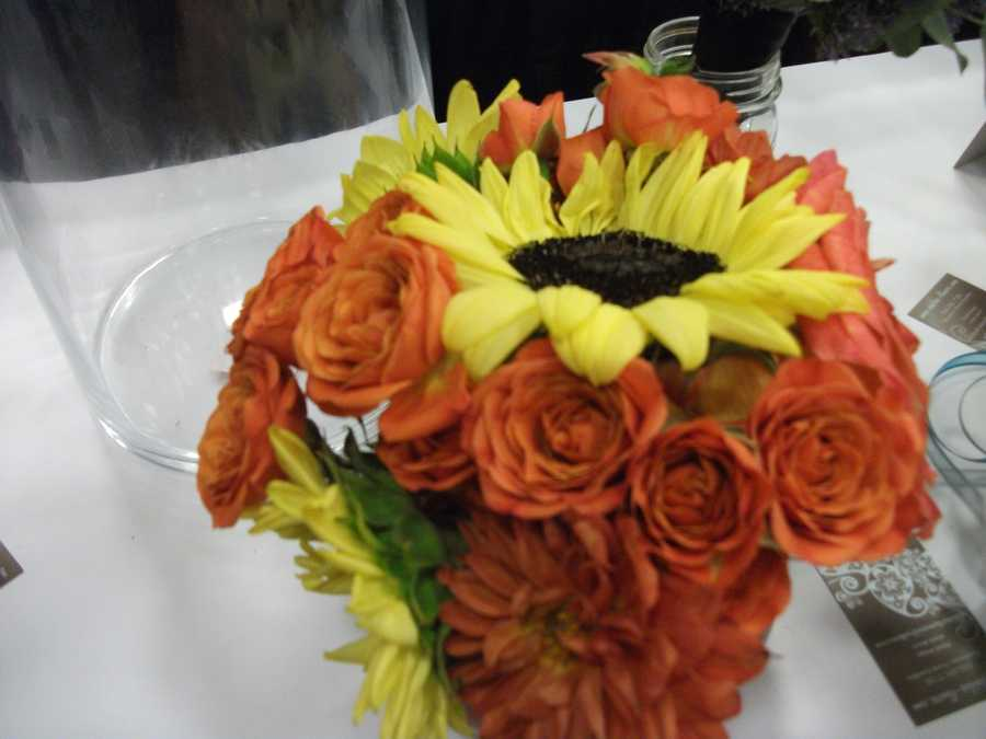 Bright orange and yellow work well for theFall, Halloween and/or Thanksgiving Themed Wedding. (Dahlias Flowers)