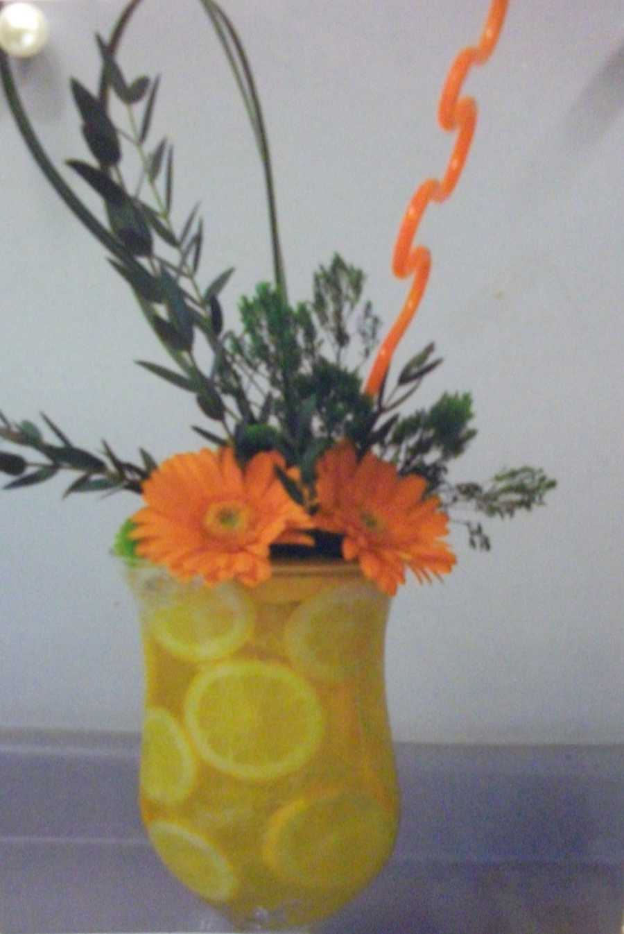 Some colorful vases with lemons or oranges and water make greatFall, Halloween and/or Thanksgiving Themed Wedding reception centerpieces. (Beverly's of Midway Flowers & Gifts)