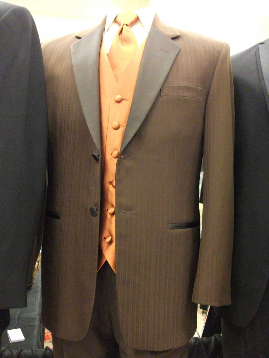This light brown and dark orange suit could be used in theFall, Halloween and/or Thanksgiving Themed Wedding for the groomsmen. (Bruce's Tuxedo)