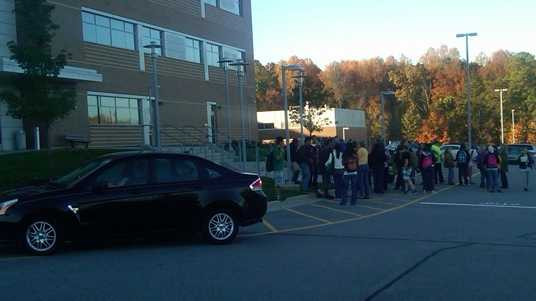GTCC students stand outside after a power outage Thursday morning. (Jeff Amernick/WXII)