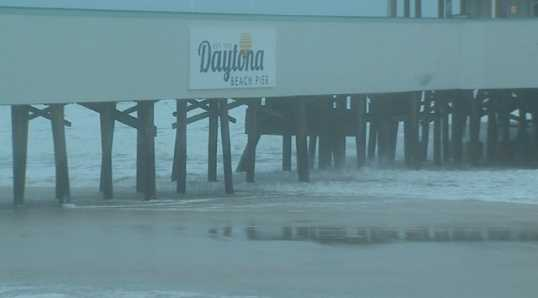 Early Friday morning, the first effects of Hurricane Sandy are seen in the U.S., as waves and wind slam into Florida.