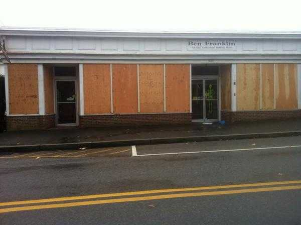 Windows boarded up Monday morning in Chatham, Mass.