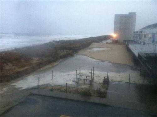At 7:30 a.m. Monday, parts of Ocean City begin to flood, including where this photo was taken near the 32nd Street dune.