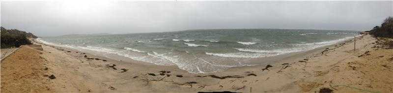 A panoramic view of the Chatham shore as the waves roll in.