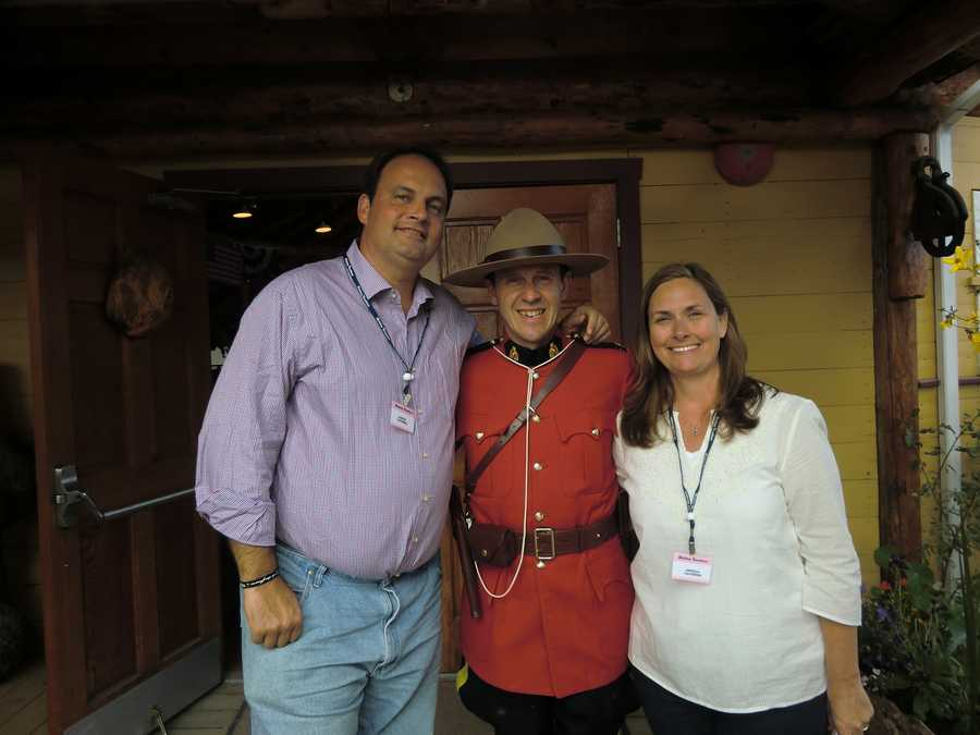 Austin and Angela with a Mounted Canadian Police in Beaver Creek, at the Rendezvous show.