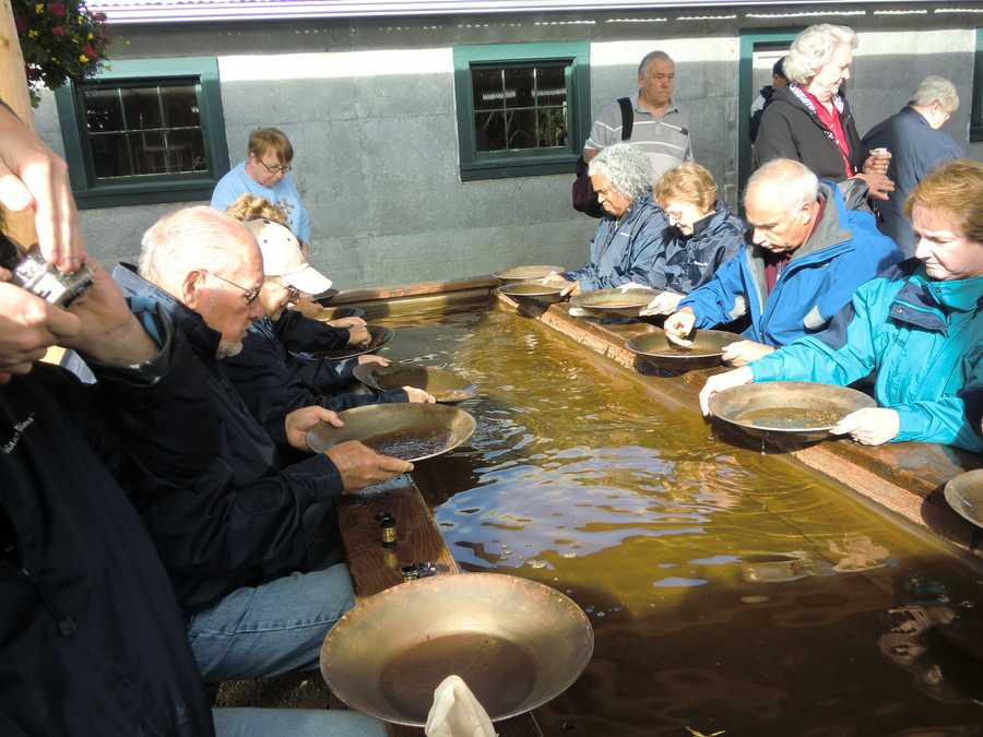 Several people in the tour group tried their luck by panning for gold at Gold Dredge 8.